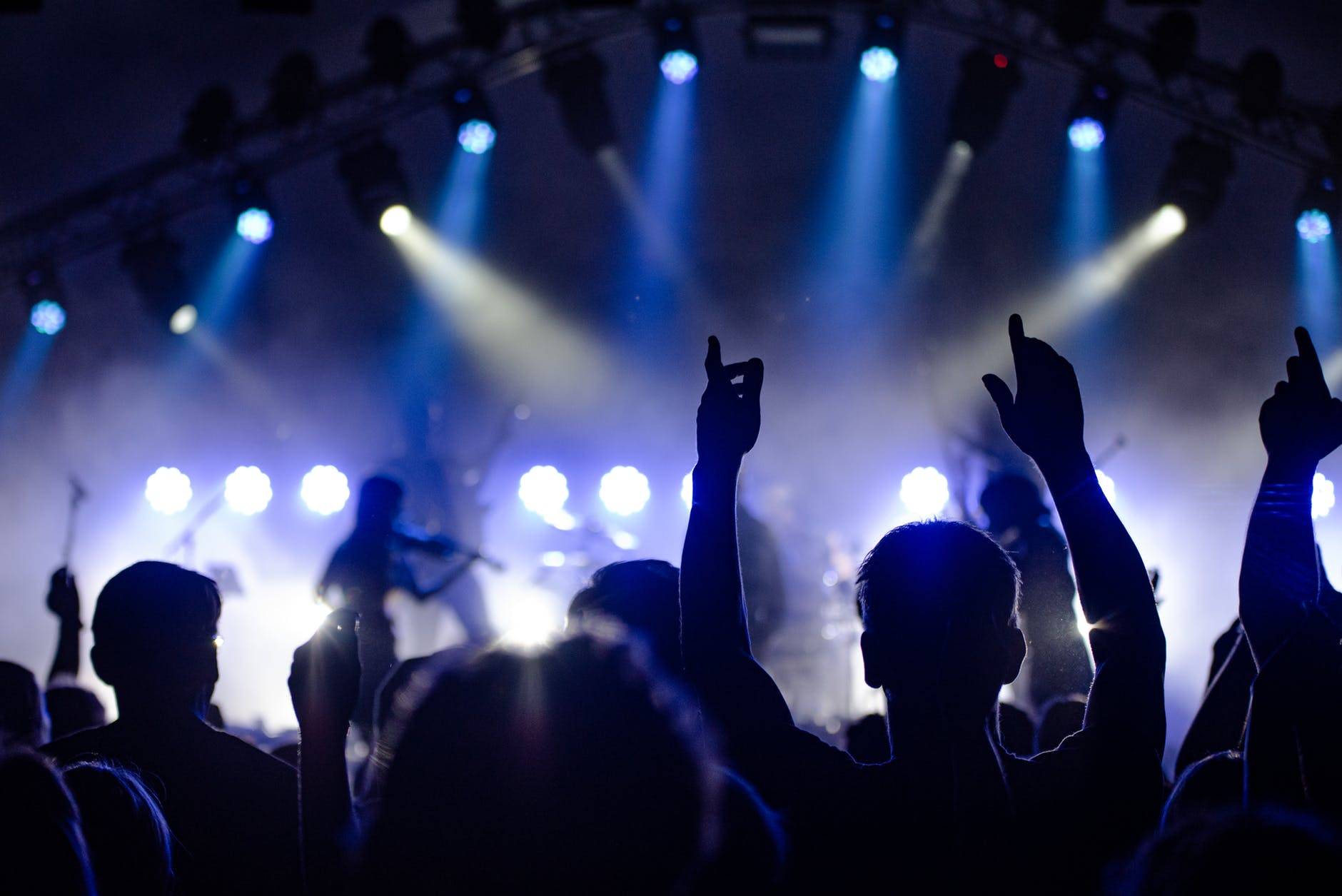 photo of people watching a concert